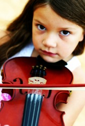 A little girl playing a fiddle.