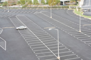 An asphalt parking lot.
