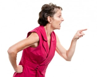 A woman engaged in finger-pointing.