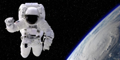 An astronaut floating in space.