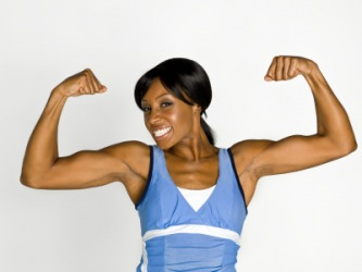 A woman flexes her muscles.