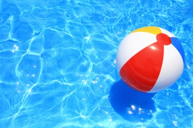 This beach ball floats on the water.