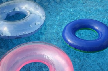 Three floating innertubes.