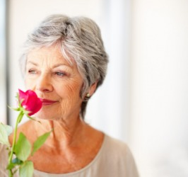 A woman with a fragrant rose.