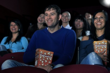 An audience at a movie theater.