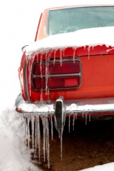 Icicles hang from a car on a frigid day.