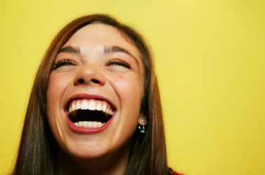 This woman is laughing at something funny.