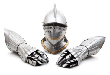 The helmet from a suit of armour with a pair of gauntlets.