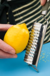 Grating a lemon.