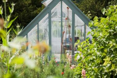 A greenhouse in an English garden.