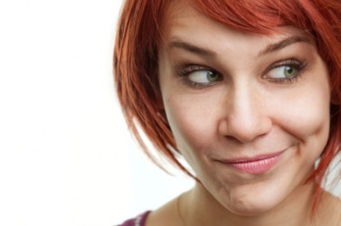 A young woman grimaces.