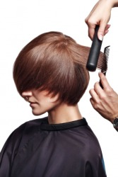 A woman having her hair styled.
