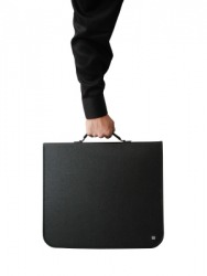 A person holds a case by its handle.
