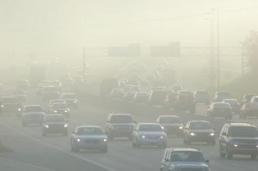 Smog created haze over a freeway.
