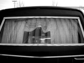 The rear window of a hearse.