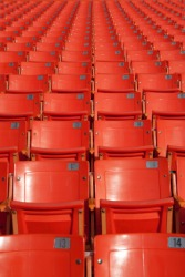 Identical seats in a stadium.