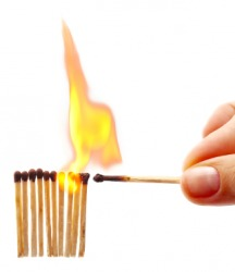A person uses one match to ignite the others.
