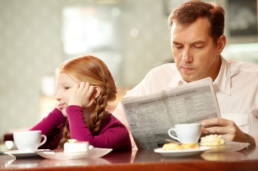 A father and daughter ignore each other.