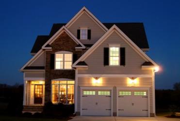 A house illuminated at night.