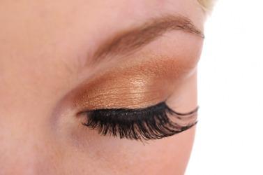 A woman wearing imitation eyelashes.