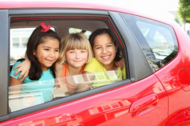 These three children are in the car.