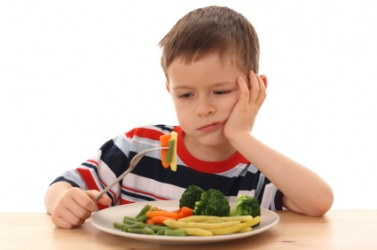 A boy showing indifference to his dinner.