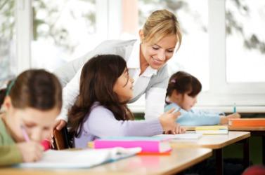A teacher instructs her class.