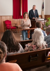 An interpreter for the deaf at a church service.