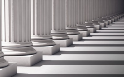 The shadows of the columns come in intervals.
