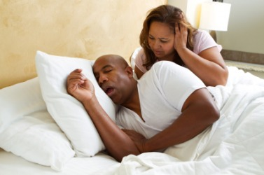 A woman finds her husbands snoring an irritation.