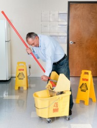 A janitor cleaning the floor.