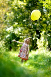 A child holding a balloon.