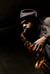 A jazz musician playing a saxophone.