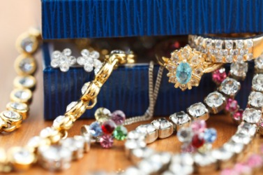 A box overflowing with jewelry.