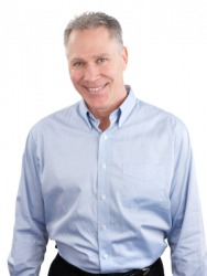 A man wearing a button-down shirt.