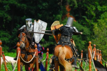 Two medieval knights participating in a joust.
