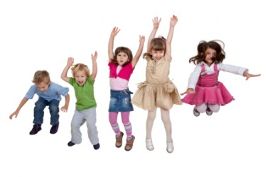 A group of children jump for joy.