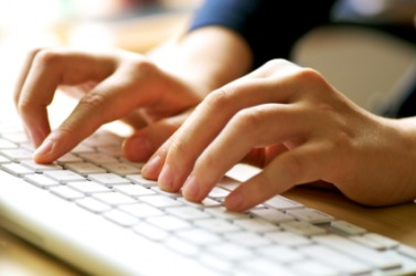 A person using a computer keyboard.