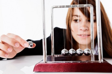 Newton's cradle is an example of the Law of Conservation of Momentum.