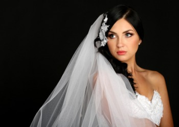 Licensed From IStockPhoto A Bride Wearing A Veil.