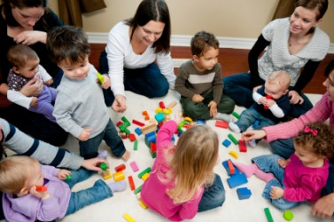 These children and adults are engaged in a social activity.