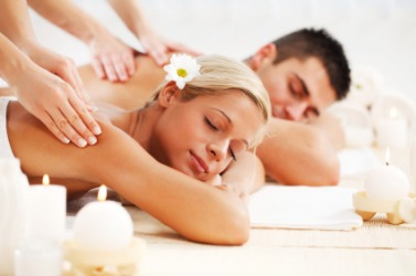 A couple enjoys the luxury of a spa.