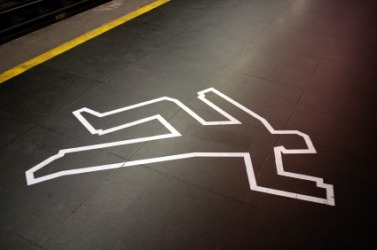 The taped outline of a body at a crime scene.