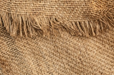 The frayed edge of a burlap sack.