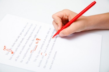 A proofreader uses a red pencil.