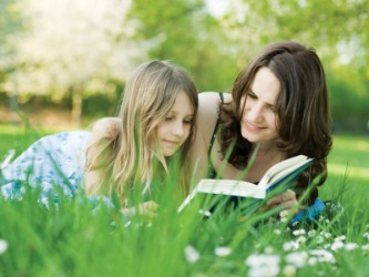 A mother shares the pleasure of reading with her daughter.