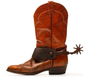 Spurs on a cowboy boot.