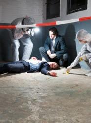 Police investigate the scene of a murder.