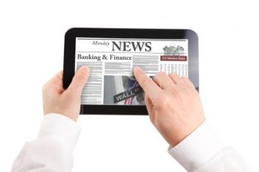 A man reads a news article.