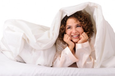 A Woman Covers Herself With Blanket